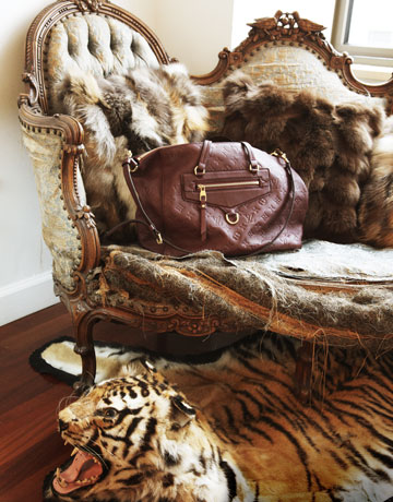Iu0027m Enamored With The Mixture Of Prints And Textures Here: The Fur Throw  Pillows, Ragged Upholstery, Leather Bag Andu2026is That A Real Tiger Hide Rug???